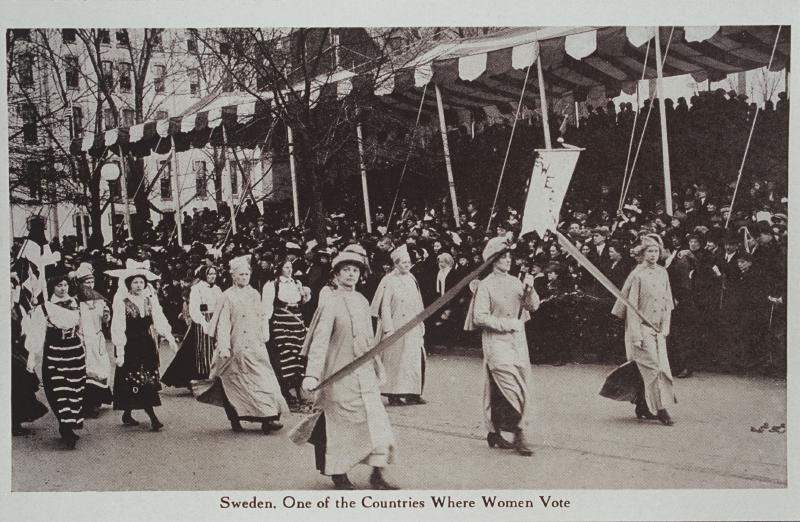 Black and white photograph of women in suffrage parade holding a banner that reads Sweden