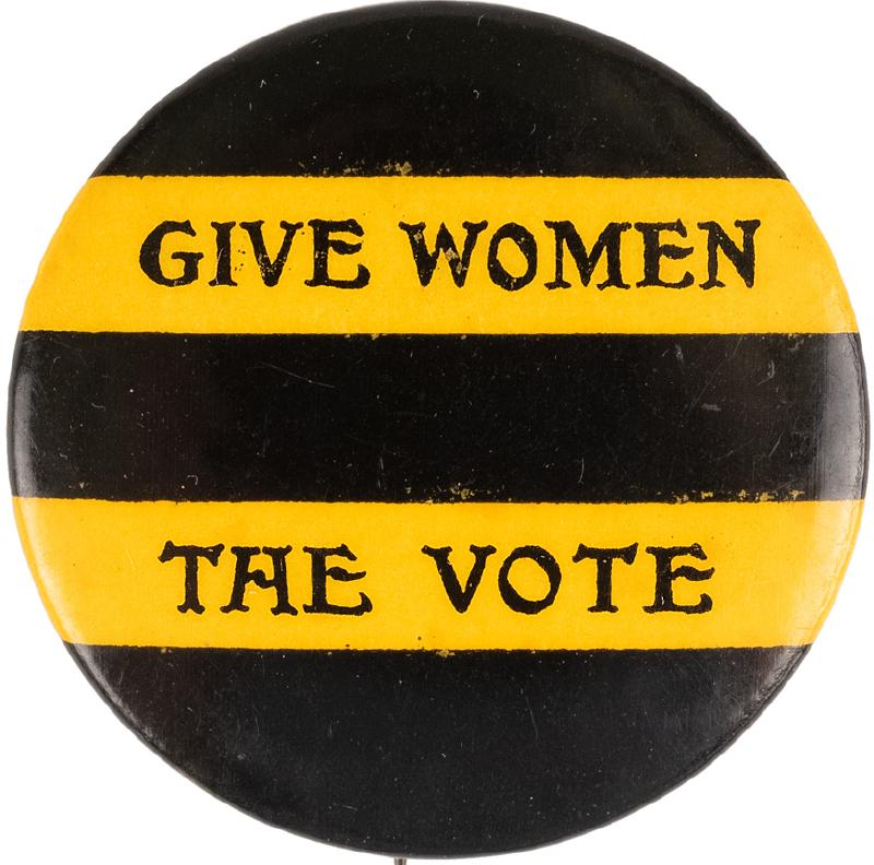 Black and yellow striped pin reading Give Women the Vote